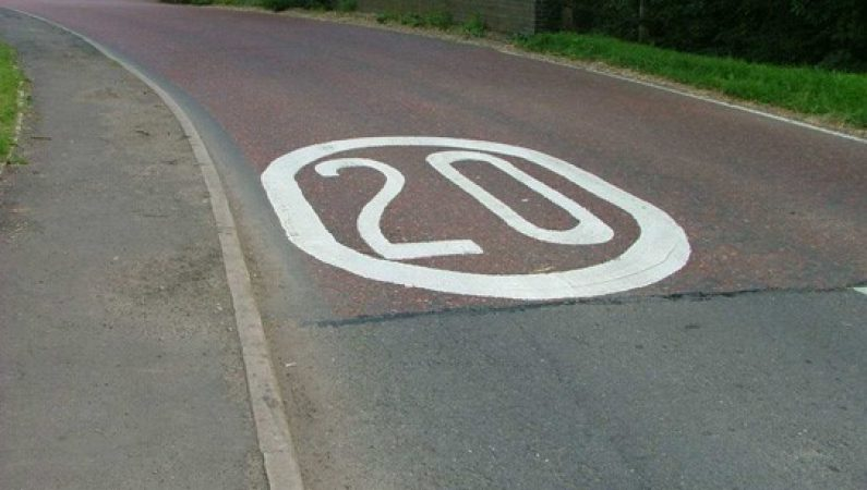 20 mph speed limit painted on the road