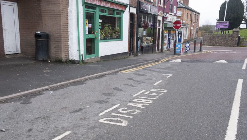Parking bay marked out with the word Disabled in it
