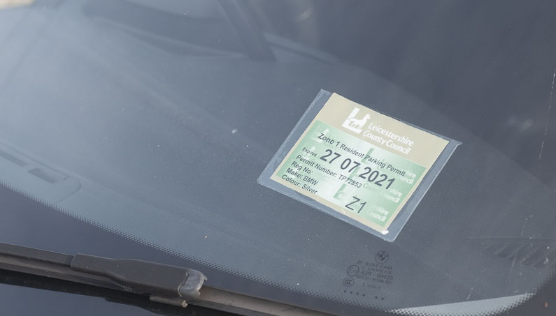 Parking permit displayed in a car windscreen