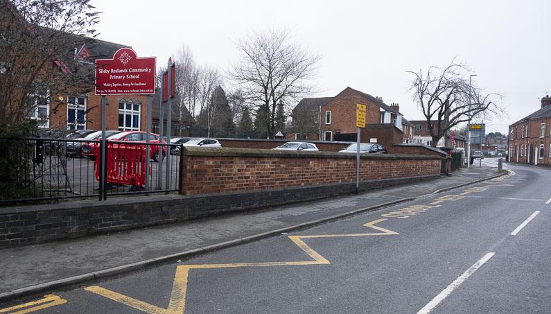 School keep clear yellow road markings outside a school