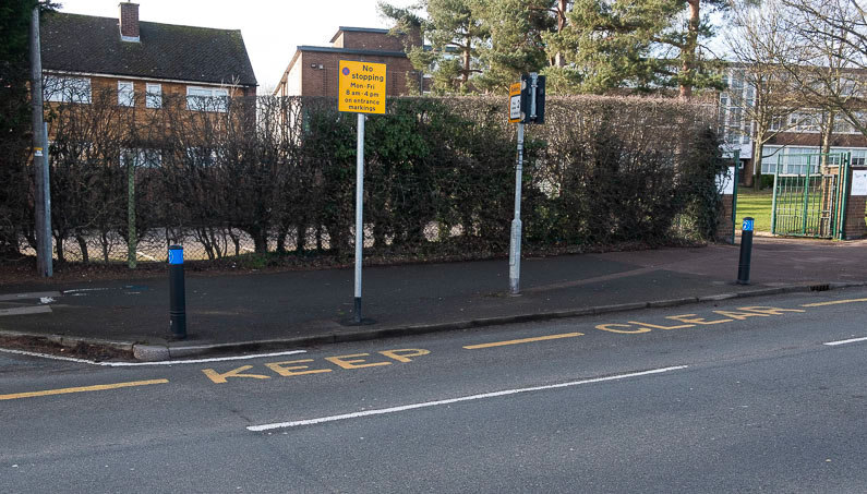 School keep clear yellow road markings and sign showing the restrictions