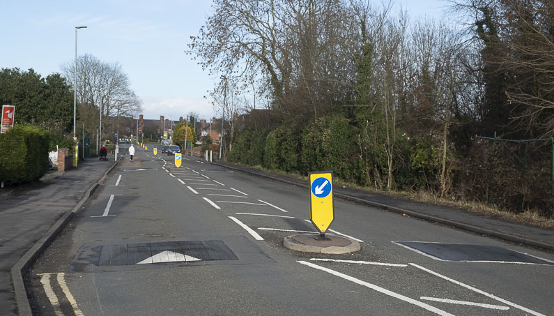 Speed cushion with a pedestrian refuge