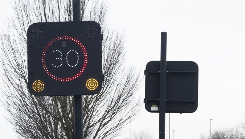Vehicle activated sign flashing 30 mph