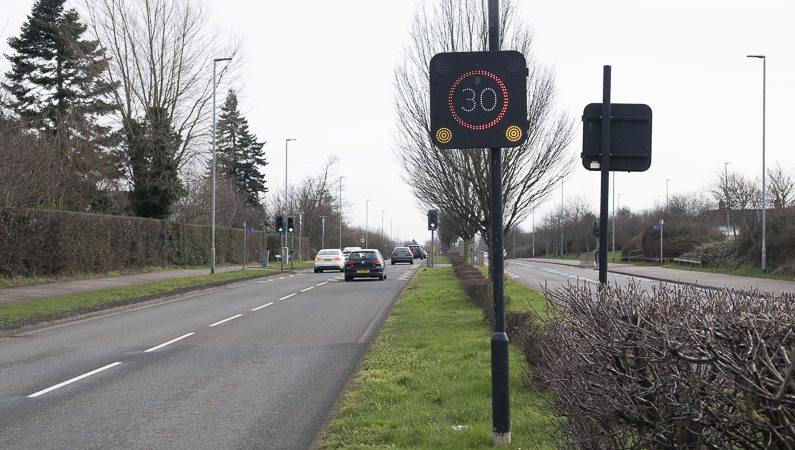 An electronic sign which displays a message or speed when triggered by a vehicle
